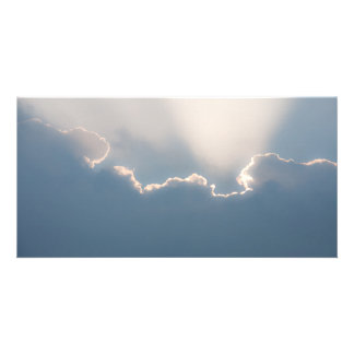 Sunshine behind clouds photo greeting card