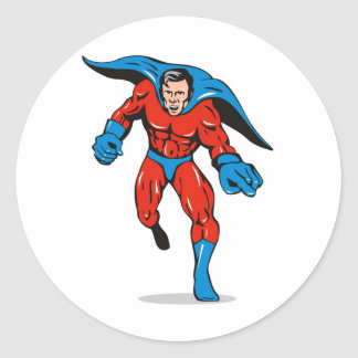 superhero caped male running flying punching classic round sticker