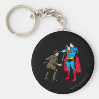 Superman bends a gun keychains