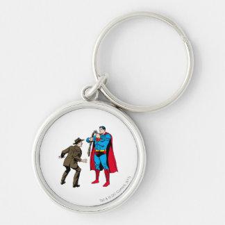 Superman bends a gun key chain