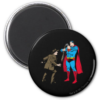 Superman bends a gun magnet