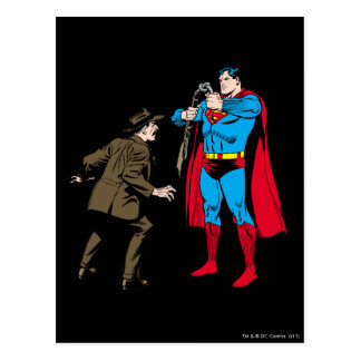 Superman bends a gun postcard