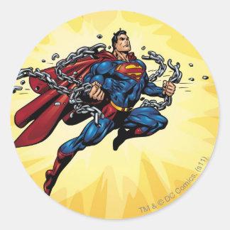 Superman breaks chains round sticker