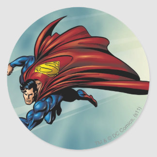 Superman flys with cape round sticker