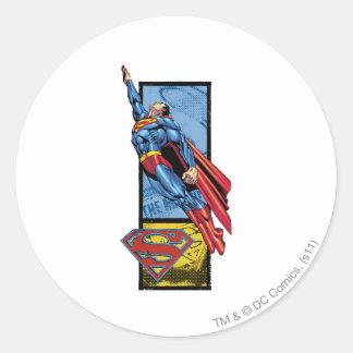 Superman jumps up with logo round sticker