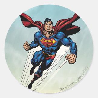 Superman leaps upward round sticker