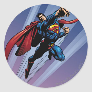 Superman with light streaks round sticker