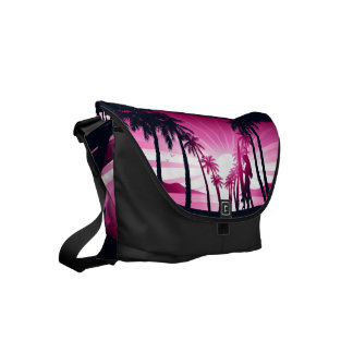 Surf board at sunrise commuter bags