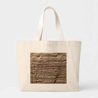 Surface of carbonate rock with weathering traces large tote bag