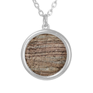 Surface of carbonate rock with weathering traces silver plated necklace