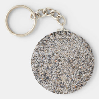 Surface of the beach from the wreckage of shells basic round button key ring