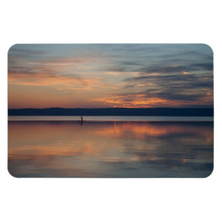 Surfer rowing to shore rectangular photo magnet