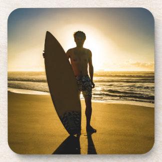 Surfer silhouette during sunrise coaster