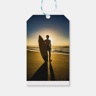 Surfer silhouette during sunrise gift tags