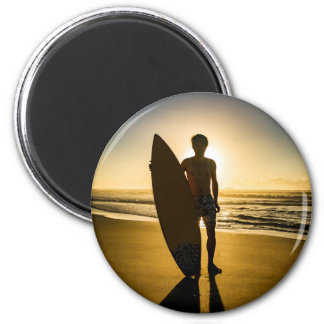 Surfer silhouette during sunrise magnet