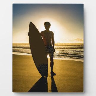 Surfer silhouette during sunrise photo plaques