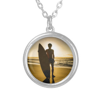 Surfer silhouette during sunrise silver plated necklace