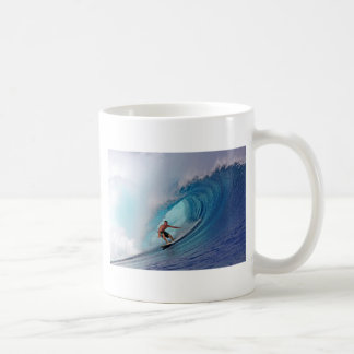 Surfer surfing a huge wave. basic white mug