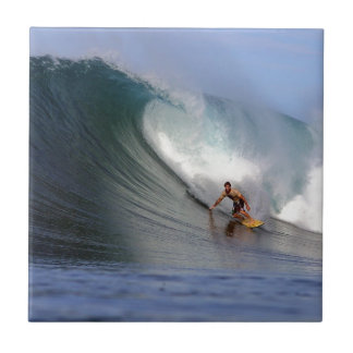 Surfer surfing huge tropical island surfing wave ceramic tile