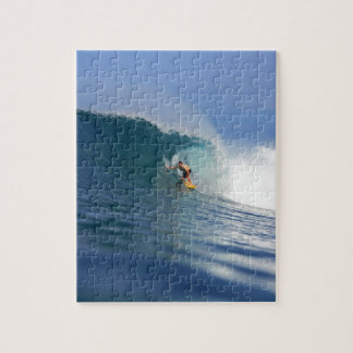 Surfer surfing large blue reef wave jigsaw puzzle