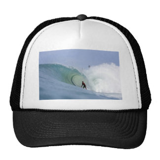 Surfer surfing large blue tropical island wave cap
