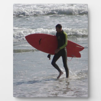 Surfer with surf board with waves plaque