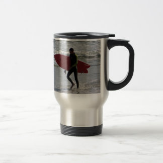 Surfer with surf board with waves travel mug