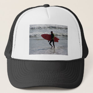 Surfer with surf board with waves trucker hat