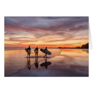 Surfers At Sunset Walking On Beach, Costa Rica Card