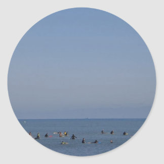 surfers waiting a wave classic round sticker