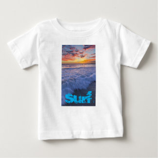 Surfing beach waves at sunset baby T-Shirt