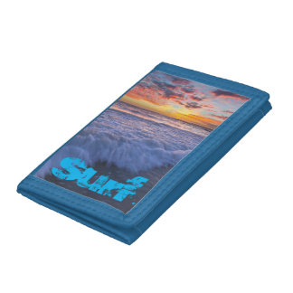 Surfing beach waves at sunset tri-fold wallet