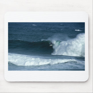 Surfing big waves in New Zealand Mouse Pad