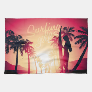 Surfing girl at sunrise tea towel
