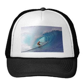 Surfing large blue wave Mentawai Islands Cap