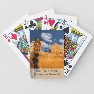 surreal horse walking fence orange blue sky bicycle playing cards