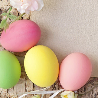 Easter Eggs and Note on Wooden Background