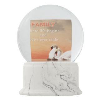 Swan family snow globe