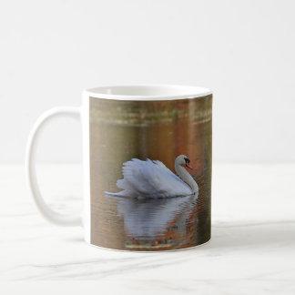 Swan swims in autumn reflections coffee mug