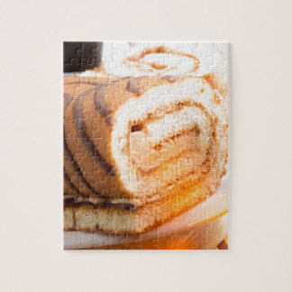 Sweet cake with chocolate cream and cup of hot tea jigsaw puzzle