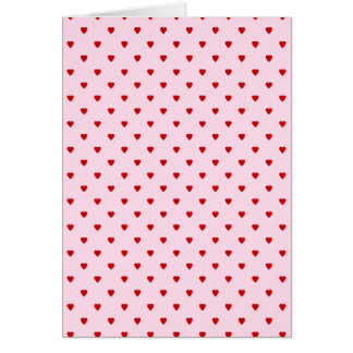 Sweet pattern of red hearts on pink. card