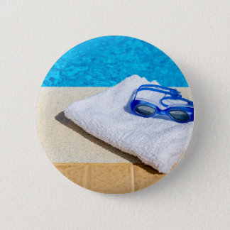 Swimming goggles and towel near swimming pool 6 cm round badge