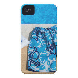 Swimming trunks goggles and towel at pool Case-Mate iPhone 4 cases
