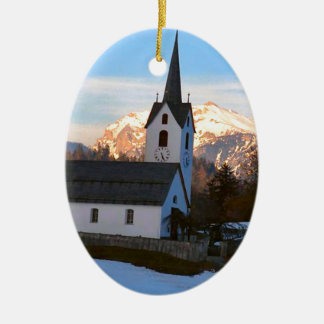 Swiss church in the mountains ceramic oval decoration