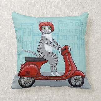 Tabby Cat on a Red Scooter Cushion