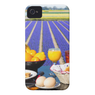 Table with food and drink near flowers field iPhone 4 covers