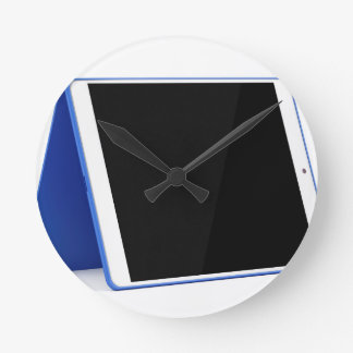 Tablet computer on white round clock