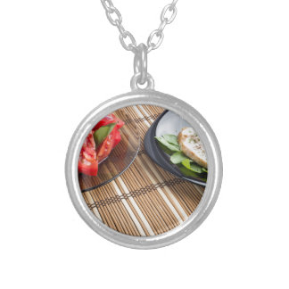 Tabletop with homemade dishes silver plated necklace