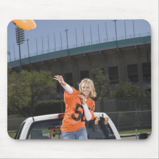 Tailgating woman throwing football mouse pad
