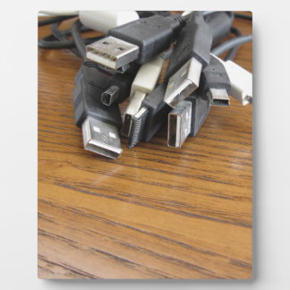 Tangle of dusty computer cables with sockets display plaque